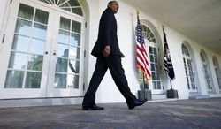 President Barack Obama walks from the Oval Office to the Rose Garden of the White House in Washington to announce Jeh Johnson as his choice for the next Homeland Security Secretary, Friday, Oct. 18, 2013. Johnson was general counsel at the Defense Department during the wars in Iraq and Afghanistan. (AP Photo/Charles Dharapak)