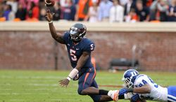 Virginia quarterback David Watford (5) throws the ball away as he is brought down by Duke defensive end Jordan DeWalt-Ondijo (94) in the first quarter of an NCAA college football game on Saturday, Oct. 19, 2013, in Charlottesville, Va. (AP Photo/The Daily Progress, Ryan M. Kelly)