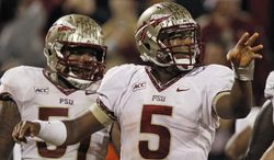 Florida State quarterback Jameis Winston (5) celebrates his touchdown run against Clemson during the second half of an NCAA college football game, Saturday, Oct. 19, 2013, in Clemson, S.C. Offensive linesman Bobby Hart is at left. (AP Photo/Mike Stewart)