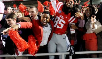 Mississippi wide receiver Ja-Mes Logan (85) celebrates with fans after an NCAA college football game against LSU in Oxford, Miss., on Saturday, Oct. 19, 2013. Mississippi won 27-24. (AP Photo/Oxford Eagle, Bruce Newman) MAGS OUT  NO SALES  MANDATORY CREDIT