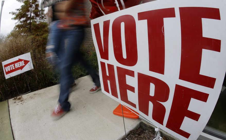 FILE - In this Nov. 6, 2012, file photo voters leave a polling place on election day in Nashville, Tenn. With the partial federal shutdown come and gone, the government now powering back up to full speed, and the next budget crisis pushed off at least until January, there is no shortage of speculation about whether voters will retaliate in the 2014 elections against lawmakers for this fall's budget impasse. A lot depends on how the next year goes.(AP Photo/Mark Humphrey, File)