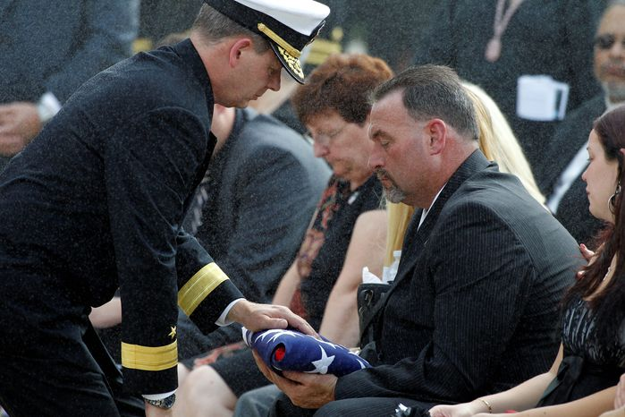 Not enough: Charlie Strange, father of Navy Petty Officer 1st Class Michael Strange, received a flag but few answers about how his son was killed on Aug. 6, 2011. He suspects someone in the Afghan government tipped off the Taliban. (Associated Press Photographs)