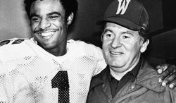 """Washington Huskies Warren Moon (l) stands with his coach, Don James, in Washington's locker room after the Rose Bowl Game in Pasadena on Monday, Jan. 2, 1978. Moon was named """"Most Valuable Player"""" of the Rose Bowl game. (AP Photo)"""