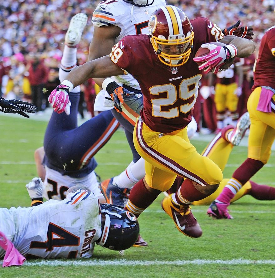 Washington Redskins running back Roy Helu runs past Chicago Bears free safety Chris Conte and into the end zone for a touchdown during the second half of a NFL football game in Landover, Md., Sunday, Oct. 20, 2013. (AP Photo/Nick Wass)