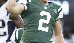 New York Jets kicker Nick Folk (2) reacts after kicking a field goal to win during overtime of an NFL football game against the New England Patriots Sunday, Oct. 20, 2013 in East Rutherford, N.J. The Jets won the game 30-27. (AP Photo/Kathy Willens)