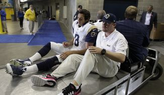 St. Louis Rams' Sam Bradford (8) is taken to the locker room after being injured in the second half of an NFL football game against the Carolina Panthers in Charlotte, N.C., Sunday, Oct. 20, 2013. (AP Photo/Chuck Burton)