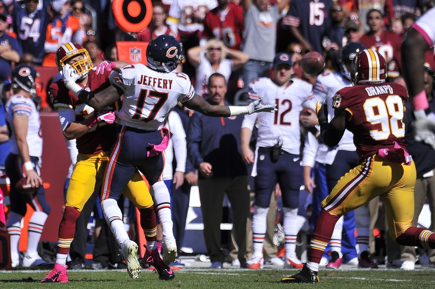 Washington Redskins outside linebacker Brian Orakpo (98) intercept a pass intended for Chicago Bears wide receiver Alshon Jeffery (17) and runs it in for the touchdown in the first quarter at FedExField, Landover, Md., October 20, 2013. (Preston Keres/Special for The Washington Times)
