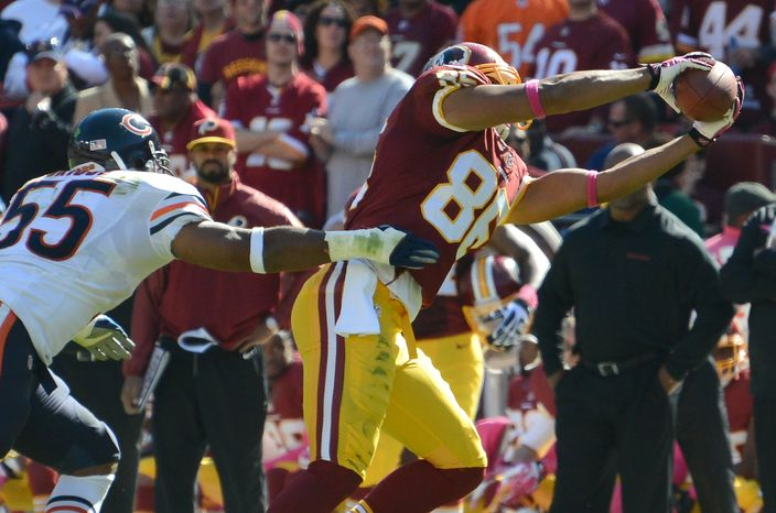 Washington Redskins tight end Jordan Reed (86) makes a first down catch as the Washington Redskins play the Chicago Bears at FedExField, Landover, Md., October 20, 2013. (Dan DeCook/Special to The Washingto