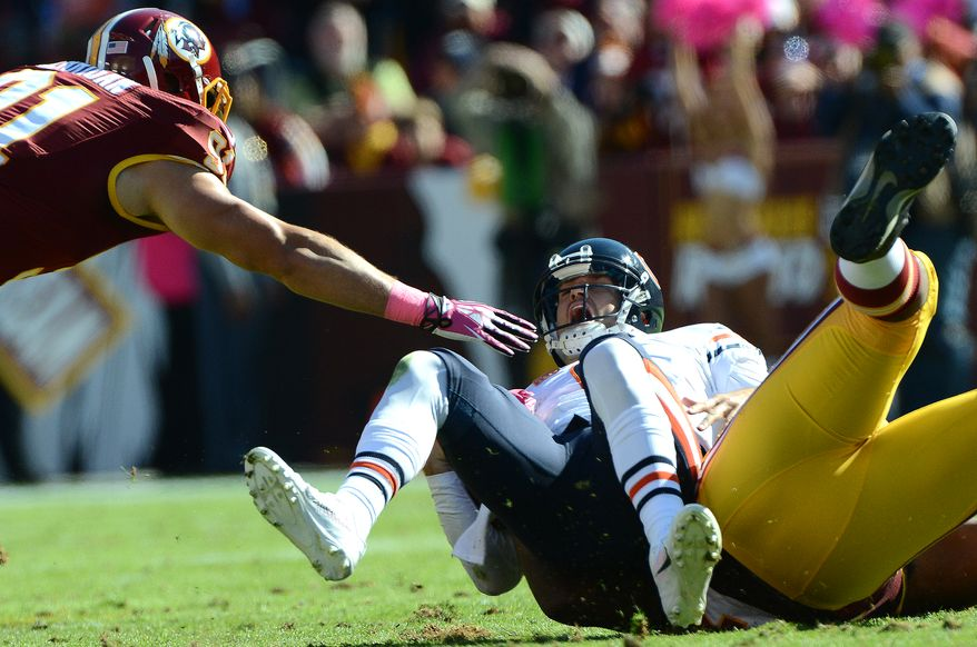 Chicago Bears quarterback Jay Cutler (6) is injured while being sacked by Washington Redskins defensive end Chris Baker (92) as the Washington Redskins play the Chicago Bears at FedExField, Landover, Md., October 20, 2013. (Dan DeCook/Special to The Washington Times)
