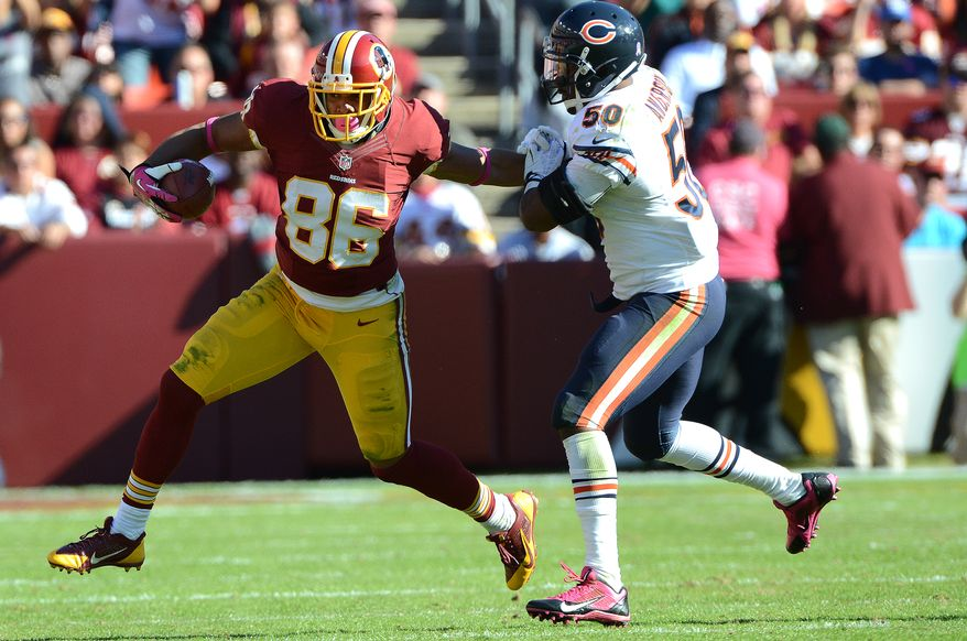 Washington Redskins tight end Jordan Reed (86) stiff arms a defender on his way to a first down as the Washington Redskins play the Chicago Bears at FedExField, Landover, Md., October 20, 2013. (Dan DeCook/Special to The Washington Times)