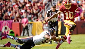 Washington Redskins quarterback Robert Griffin III (10) scrambles for a gain in the first quarter as the Washington Redskins play the Chicago Bears at FedExField, Landover, Md., Sunday, October 20, 2013. (Andrew Harnik/The Washington Times)
