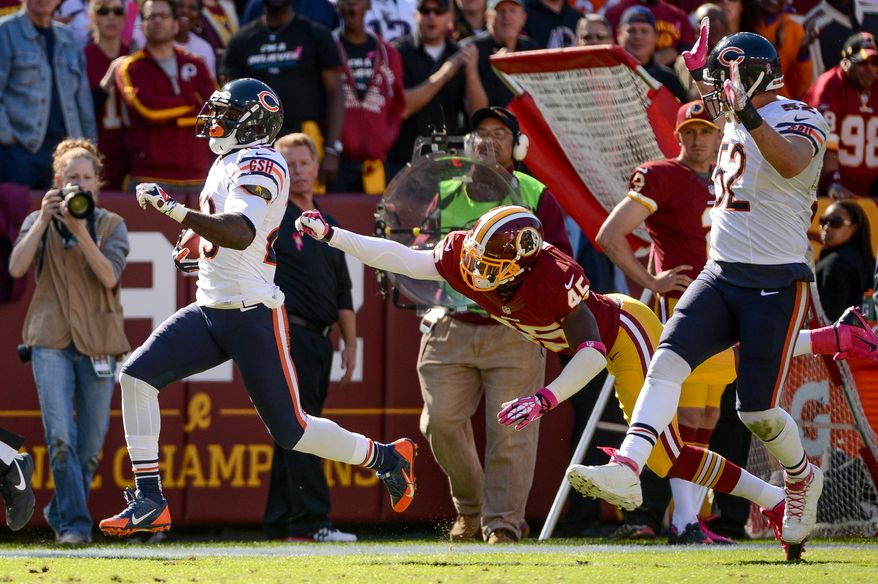 Chicago Bears wide receiver Devin Hester (23) returns a punt return for a touchdown in the second quarter as the Washington Redskins play the Chicago Bears at FedExField, Landover, Md., Sunday, October 20, 2013. (Andrew Harnik/The Washington Times)