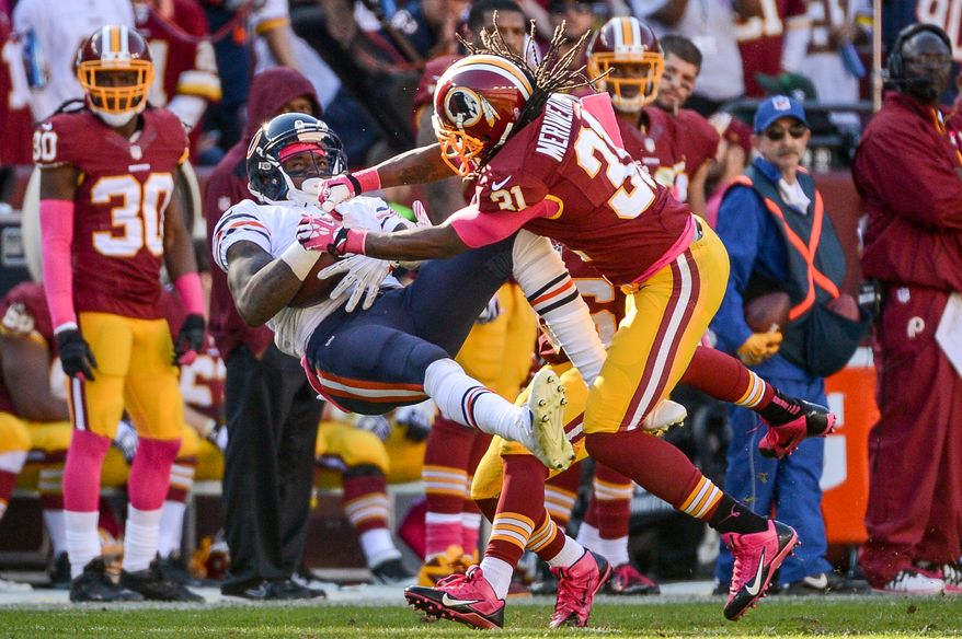 Washington Redskins strong safety Brandon Meriweather (31) is flagged for a helmet to helmet hit on Chicago Bears wide receiver Alshon Jeffery (17) in the third quarter as the Washington Redskins play the Chicago Bears at FedExField, Landover, Md., Sunday, October 20, 2013. (Andrew Harnik/The Washington Times)