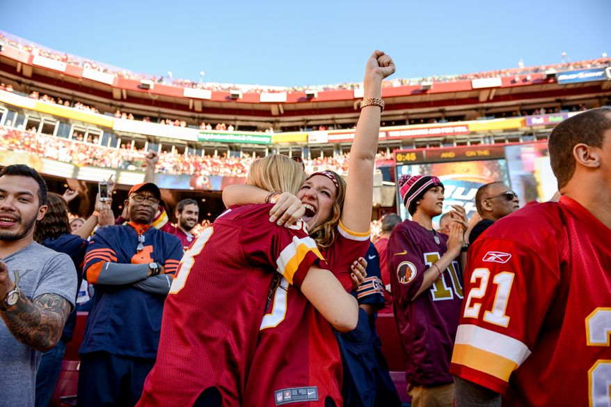 Hillary Mozeik of Ocean City, Md., left, and Alyssa Kress of Olney, Md., right, celebrates as Washington Redskins running back Roy Helu (29) scores the go-ahead touchdown on a 3 yard run late in the fourth quarter as the Washington Redskins defeat the Chicago Bears 45-41 at FedExField, Landover, Md., Sunday, October 20, 2013. (Andrew Harnik/The Washington Times)