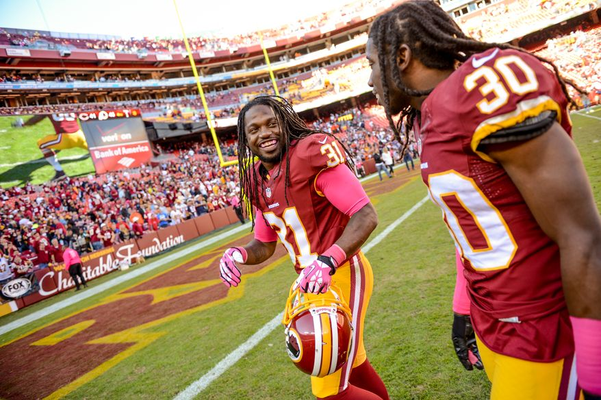 Washington Redskins strong safety Brandon Meriweather (31) and Washington Redskins cornerback E.J. Biggers (30) leave the field as the Washington Redskins defeat the Chicago Bears 45-41 at FedExField, Landover, Md., Sunday, October 20, 2013. (Andrew Harnik/The Washington Times)