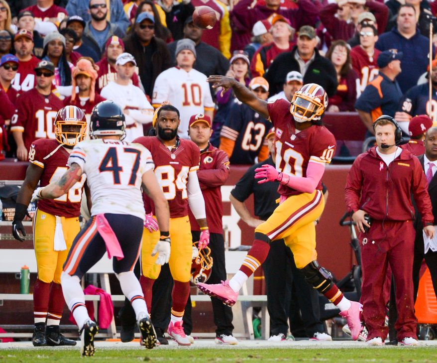 Washington Redskins quarterback Robert Griffin III (10) makes a crucial third down pass to Washington Redskins tight end Jordan Reed (86) for 10 yards to keep the drive alive late in the fourth quarter as the Washington Redskins play the Chicago Bears at FedExField, Landover, Md., Sunday, October 20, 2013. (Andrew Harnik/The Washington Times)