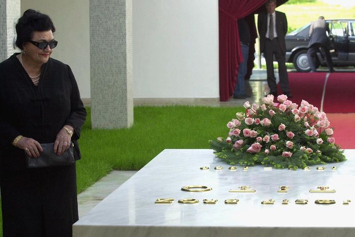 Jovanka Broz, the widow of former Yugoslav President Josip Broz Tito, stands by his tomb after laying a wreath during a ceremony in Belgrade, Serbia, on Friday, May 4, 2001. (AP Photo/Darko Vojinovic)