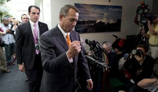 ** FILE ** In this Oct. 16, 2013, file photo Speaker of the House Rep. John Boehner, R-Ohio, pumps his fist as he leaves a meeting with House Republicans on Capitol Hill in Washington during the third week of the partial federal government shutdown. (AP Photo/ Evan Vucci, File)