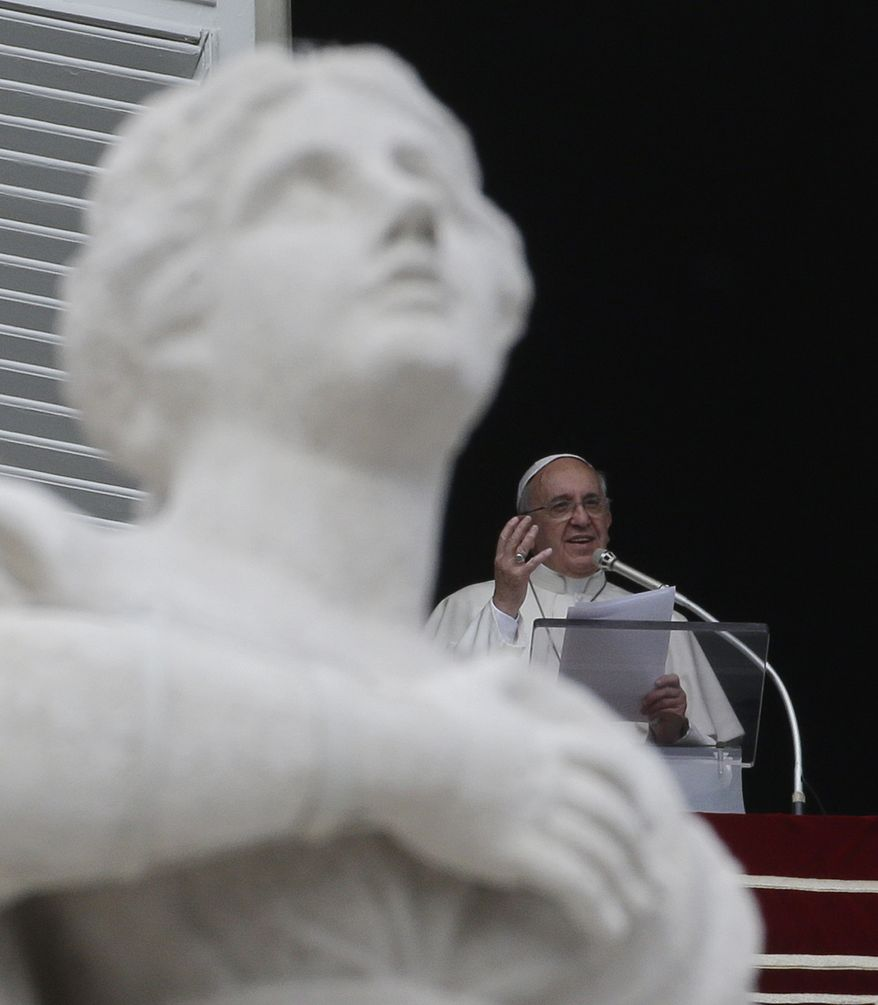 Pope Francis delivers his message from his studio window overlooking the crowd gathered in St. Peter's Square during his Angelus prayer, at the Vatican, Sunday, Oct. 20, 2013. During the Angelus the pontiff expressed his closeness to the Philippines for the recent 7.2 magnitude earthquake which left at least 171 people dead. (AP Photo/Gregorio Borgia)