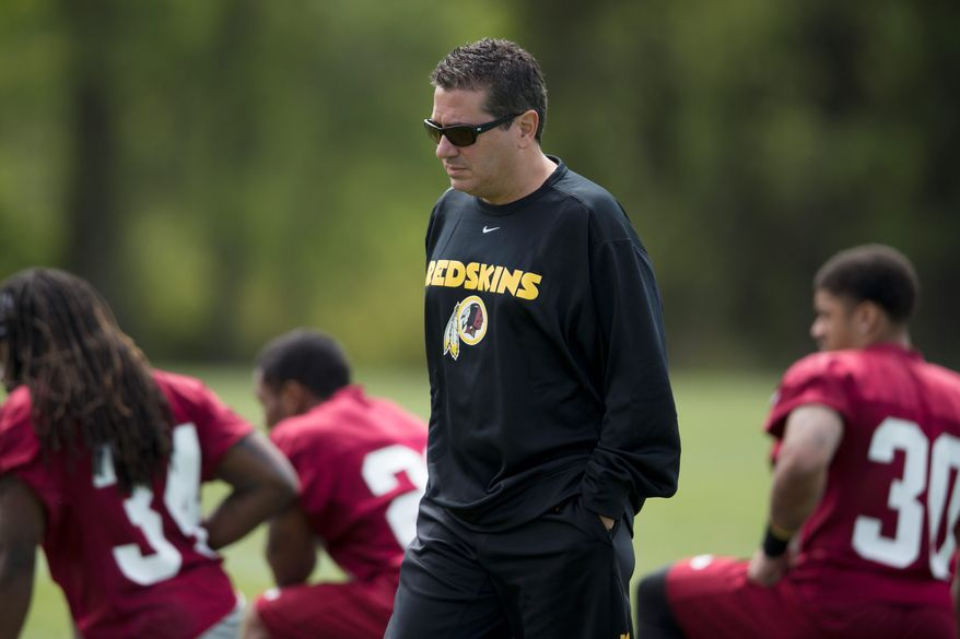 "Washington Redskins owner Dan Snyder has vowed never to abandon his team's name, despite remarks by President Obama that American Indians ""feel pretty strongly"" about mascots and team names that depict negative stereotypes about their heritage. (Associated Press Photographs)"