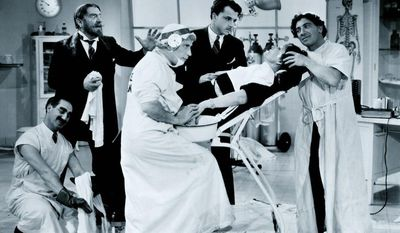 "The Marx Brothers tend to Margaret Dumont's medical needs in a scene from ""A Day at The Races"""