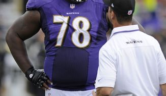 Baltimore Ravens tackle Bryant McKinnie speaks with Ravens head coach John Harbaugh in the second half of an NFL football game against the Houston Texans, Sunday, Sept. 22, 2013, in Baltimore. (AP Photo/Nick Wass)