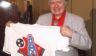 FILE -- This is a June 12, 1997, file photo shows Houston Oilers owner Bud Adams showing off a T-shirt, in Nashville,  with the new logo the team will use when it moves to Tennessee.  (AP Photo/Mark Humphrey, File)