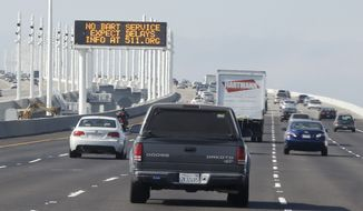 ** FILE ** A traffic sign on the San Francisco-Oakland Bay Bridge alerts motorists to expect delays because of the BART transit strike Monday, Oct. 21, 2013, in Oakland, Calif. (AP Photo/Eric Risberg)