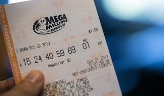 Mega Millions ticket holders will now have a better chance at winning due to an increase in numbers (up to 75), now 1-in-14.71 have a chance to win any prize, in Alexandria, VA., Monday, October 21, 2013.  (Andrew S Geraci/The Washington Times)