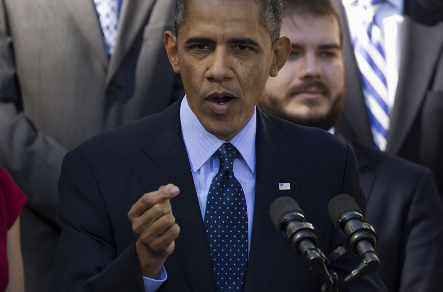 President Barack Obama gestures while speaking in the Rose Garden of the White House in Washington, Monday, Oct. 21, 2013, on the initial rollout of the health care overhaul. Obama acknowledged that the widespread problems with his health care law's rollout are unacceptable, as the administration scrambles to fix the cascade of computer issues.(AP Photo/ Evan Vucci)