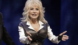 ** FILE ** This Jan. 19, 2012, file photo shows entertainer Dolly Parton during a news conference in Nashville, Tenn., to announce plans for a water-snow park. Parton was treated and released at a Nashville, Tenn., hospital Monday, Oct. 21, 2013, after a car she was riding in was involved in an accident. (AP Photo/Mark Humphrey, File)