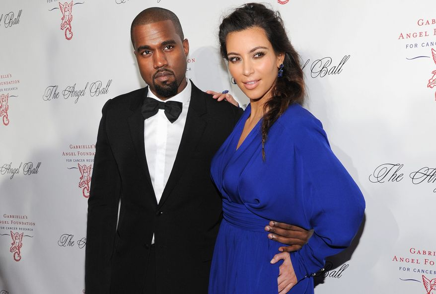 Rapper Kanye West proposed to Kim Kardashian on Monday, Oct. 21, 2013, at AT&T Park, home of the San Francisco Giants, with family and friends in attendance. (Invision via Associated Press)
