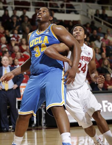 **FILE** UCLA center Josh Smith (34) waits for the rebound in front of Stanford forward Josh Huestis (24) in the first half of an NCAA college basketball game in Stanford, Calif., Thursday, Dec. 29, 2011. (AP Photo/Paul Sakuma)