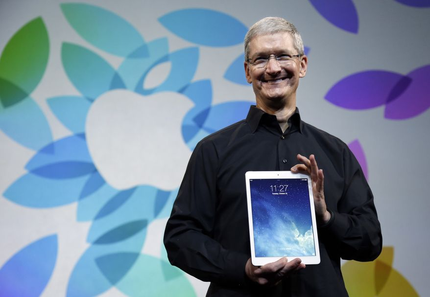Apple CEO Tim Cook introduces the new iPad Air on Tuesday, Oct. 22, 2013, in San Francisco. (AP Photo/Marcio Jose Sanchez)
