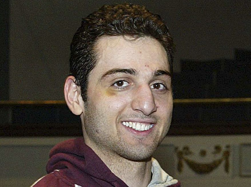 ** FILE ** In this Feb. 17, 2010, file photo, Tamerlan Tsarnaev smiles after accepting the trophy for winning the 2010 New England Golden Gloves Championship in Lowell, Mass. Prosecutors in the case against Boston Marathon bombing suspect Dzhokhar Tsarnaev, Tamerlan's brother, say a man shot to death during questioning by an agent in Florida told investigators that Tamerlan had been involved in a triple homicide (AP Photo/The Lowell Sun, Julia Malakie File)