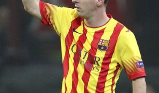 Barcelona's Lionel Messi celebrates after scoring during a Champions League, Group H, soccer match between AC Milan and Barcelona at the San Siro stadium in Milan, Italy, Tuesday, Oct. 22, 2013. (AP Photo/Antonio Calanni)