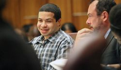 Eric Rivera smiles in the courtroom while chatting with his attorney during Rivera's  murder trial in the Dade County Criminal Court on Tuesday, Oct. 22, 2013, in Miami, Fla.  Rivera is accused in the murder of Washington Redskins star Sean Taylor.  (AP Photo/El Nuevo Herald,C.M. Guerrero )  MAGS OUT