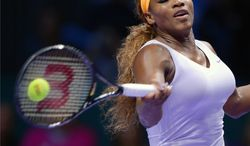 Serena Williams of the US returns a shot to Angelique Kerber of Germany during their tennis match at the WTA championship in Istanbul, Turkey, Tuesday, Oct. 22, 2013. The world's top female tennis players compete in the championships which runs from Oct. 22 until Oct. 27. (AP Photo)