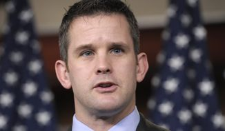 Rep. Adam Kinzinger, Illinois Republican, speaks during a news conference on Capitol Hill in Washington in this Dec. 19, 2011, file photo. (Associated Press)