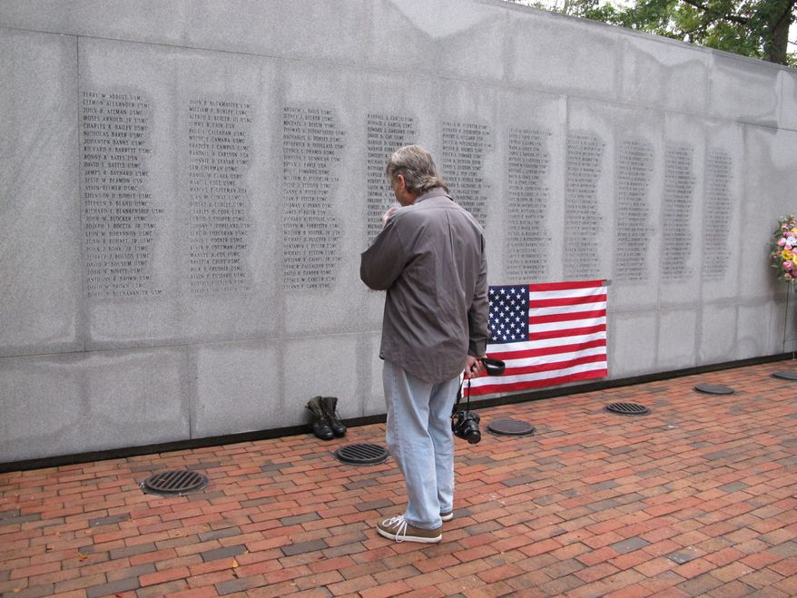 "Ed Ayers, a former Marine, of Scranton, Pa., pauses at the Beirut Bombing Memorial in Jacksonville, N.C., on Wednesday, Oct. 23, 2013, the 30th anniversary of a terrorist bombing that killed 241 U.S. service members. Mr. Ayers, who did two tours in Lebanon, said the peacekeeping mission there was worth it, but ""I wish it was handled differently."" (AP Photo/Allen G. Breed)"