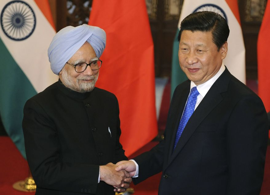 Chinese President Xi Jinping, right, shakes hands with India's Prime Minister Manmohan Singh before their meeting at the Diaoyutai State Guesthouse in Beijing Wednesday, Oct. 23, 2013. (AP Photo/Peng Sun, Pool)