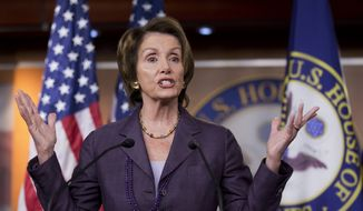 House Minority Leader Nancy Pelosi, California Democrat, gestures as she speaks to reporters during a news conference on Capitol Hill in Washington on Wednesday, Oct. 23, 2013. (AP Photo/Manuel Balce Ceneta)