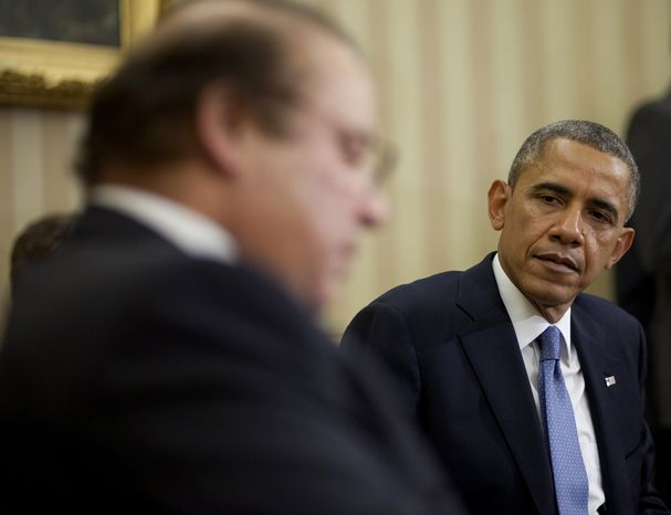 ** FILE ** President Barack Obama meets with Pakistan Prime Minister Nawaz Sharif in the Oval Office of the White House in Washington, Wednesday, Oct. 23, 2013. In the rocky relationship between the U.S. and Pakistan, the mere fact that Obama and Sharif sit down is seen as a sign of progress. Few breakthroughs are expected on the numerous hot-button issues on their agenda Wednesday, including American drone strikes and Pakistan's alleged support of the Taliban. (AP Photo/Pablo Martinez Monsivais)