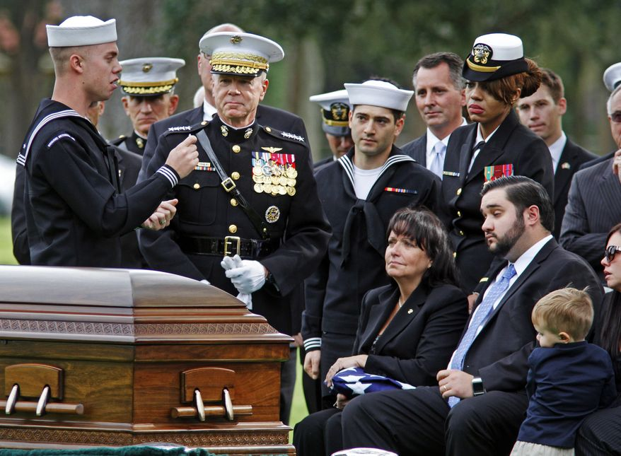 U.S. Navy corpsman Matt Ivy, left, standing next top Marine Corps General James F. Amos spoke about how Marines always watch out for one another during the burial service of Congressman C.W. Bill Young at Bay Pines National Cemetery, Thursday, Oct. 24, 2013, in St. Petersburg, Fla. Young, a 82-year-old Pinellas County Republican who served in Congress for 22 terms, died last week, surrounded by friends and family, at Walter Reed Medical Center in Bethesda, Md. (AP Photo/The Tampa Bay Times, Jim Damaske) TAMPA OUT; CITRUS COUNTY OUT; PORT CHARLOTTE OUT; BROOKSVILLE HERNANDO OUT; USA TODAY OUT; MAGS OUT