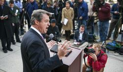 Maryland Attorney General, and Democratic gubernatorial candidate, Doug Gansler meets with reporters to explain his actions during a summertime visit to a teenage house party, Thursday, Oct. 24, 2013, in Silver Spring, Md. (AP Photo/Cliff Owen)