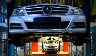 Mercedes Benz C-class cars move down the assembly line at the Mercedes plant in Sindelfingen, Germany, on 
