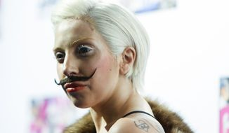 "Lady Gaga arrives for a presentation of her upcoming new album ""Artpop"" at a fan event at the Berghain club in Berlin, Thursday, Oct. 24, 2013.  (AP Photo/Markus Schreiber)"
