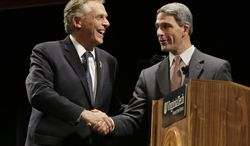 Democratic gubernatorial candidate Terry McAuliffe (left) shakes hands with Virginia Attorney General Kenneth T. Cuccinelli II, the Republican candidate, after a debate at Virginia Polytechnic Institute and State University in Blacksburg, Va., on Thursday, Oct. 24, 2013. (AP Photo/Steve Helber)
