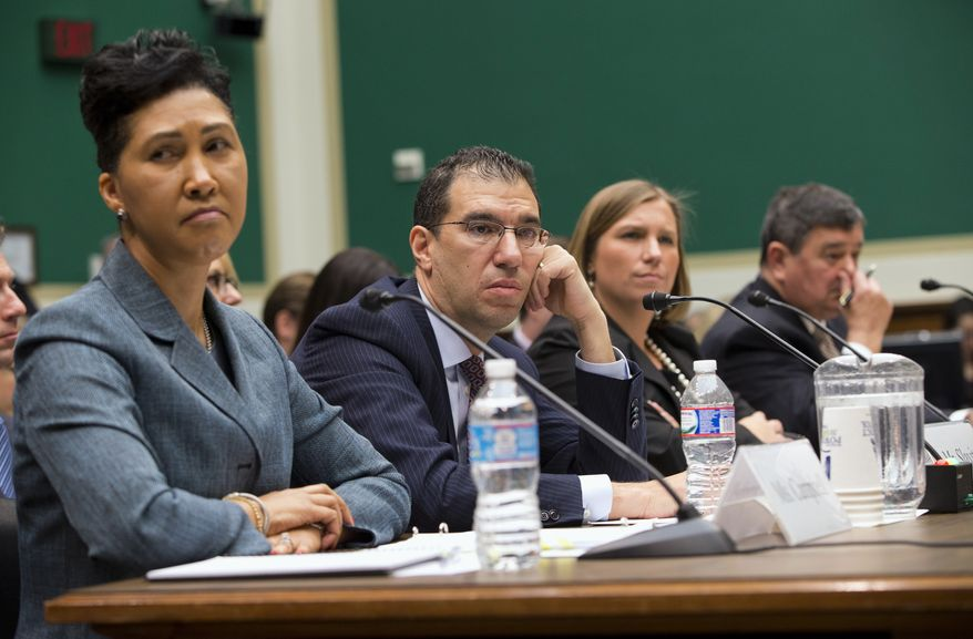 From left, Cheryl Campbell, senior vice president of CGI Federal; Andrew Slavitt, group executive vice president for Optum/QSSI; Lynn Spellecy, corporate counsel for Equifax Workforce Solutions; and John Lau, program director for Serco, listen to questioning on Capitol Hill in Washington, Thursday, Oct. 24, 2013, during a House Energy and Commerce Committee hearing with contractors that built the federal government's health care websites. The contractors responsible for building the troubled Healthcare.gov website say it was the government's responsibility _ not theirs _ to test it and make sure it worked. (AP Photo/ Evan Vucci)