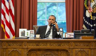 President Barack Obama talks on the phone in the Oval Office, Sept. 27, 2013. (Official White House Photo by Pete Souza)